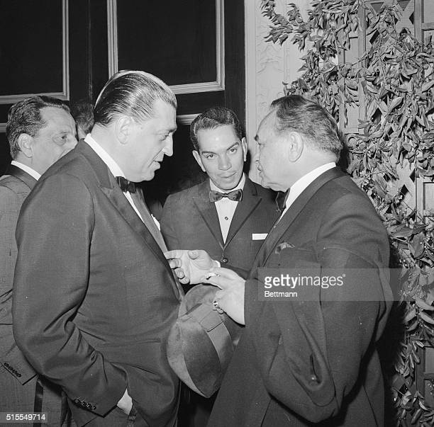 Hollywood tough guy Edward G. Robinson gestures characteristically as the actor chats with Jacques Gelman, associate producer of Pepe, during...