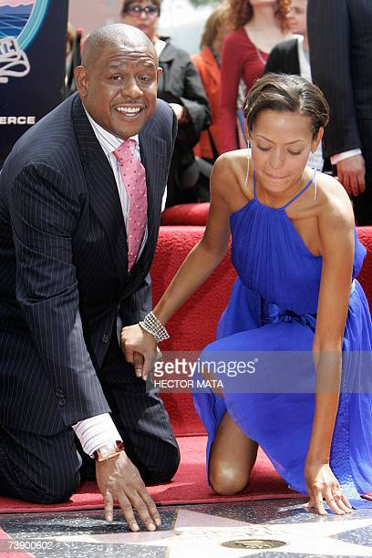 Actor Forest Whitaker and his wife Keisha touch his star at the Hollywood Walk of Fame in Hollywood CA 16 April 2007 Best Actor Academy Award winner...