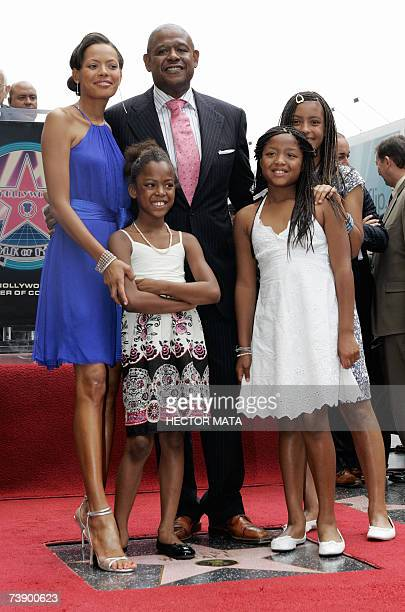 Actor Forest Whitaker his wife Keisha and their three daughters pose near his star on the Hollywood Walk of Fame in Hollywood CA 16 April 2007 Best...