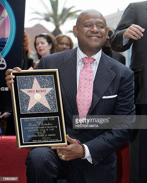 Actor Forest Whitaker poses with the plaque replica of his star on the Hollywood Walk of Fame in Hollywood CA 16 April 2007 Best Actor Academy Award...