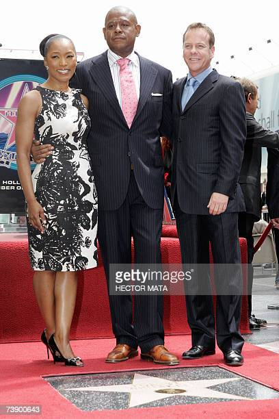 Actors Angela Basset Forest Whitaker and Kiefer Sutherland pose before Forest's star on the Hollywood Walk of Fame in Hollywood CA 16 April 2007 Best...