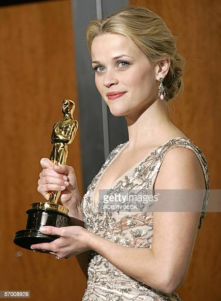 Actress Reese Whitherspoon poses with her Oscar for Best Actress 05 March during the 78th Academy Awards the Kodak Theater in Hollywood California...