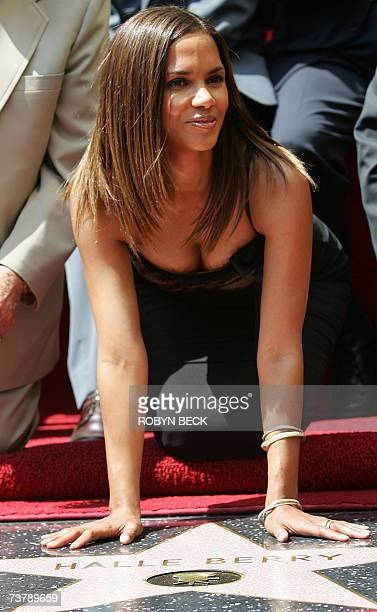 American actress Halle Berry poses with her new star on the Hollywood Walk of Fame at a ceremony to present the Academy Awardwinning actress with her...