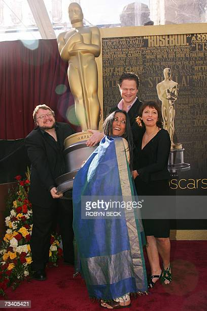 Four of the five Academy Award nominated directors in the Foreign Language Film Award Category pose with an Oscar statue outside the Kodak Theatre in...