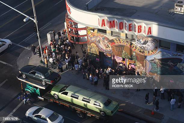 People wait in line to see Paul McCartney in a free concert 27 June 2007 outside the Amoeba record store where the former Beatle will be performing...