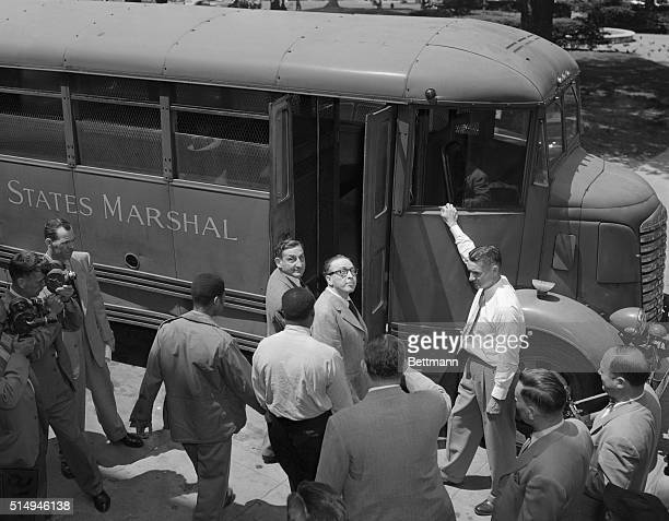 Hollywood writers John Howard Lawson and Dalton Trumbo enter van to be taken to DC jail after they were sentenced to one year in jail and fined $1000...