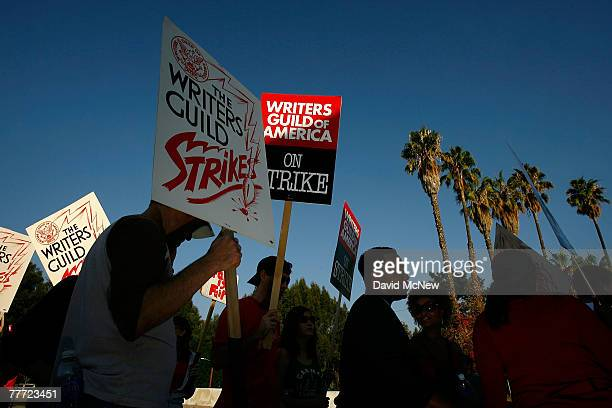 Hollywood writers walk a picket line near a gate to the CBS Radford Studios after contract talks between the Writers Guild of America and the...