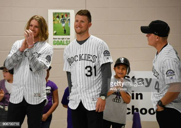 Holm Elementary School 4th grader Emmanuel SalmeronSanchez third from left gets a better vantage point to see Colorado Rockies players left to right...