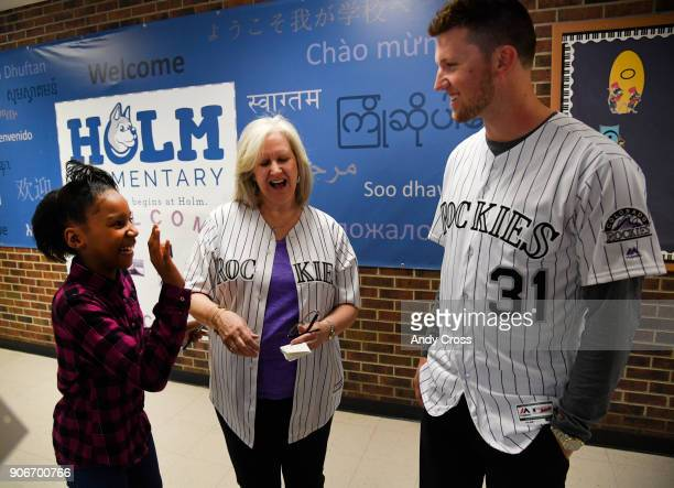 Holm Elementary School 4th grader Marneeya Maxwell left greets Colorado Rockies pitcher Kyle Freeland right and Kyle's mother Susan after the...