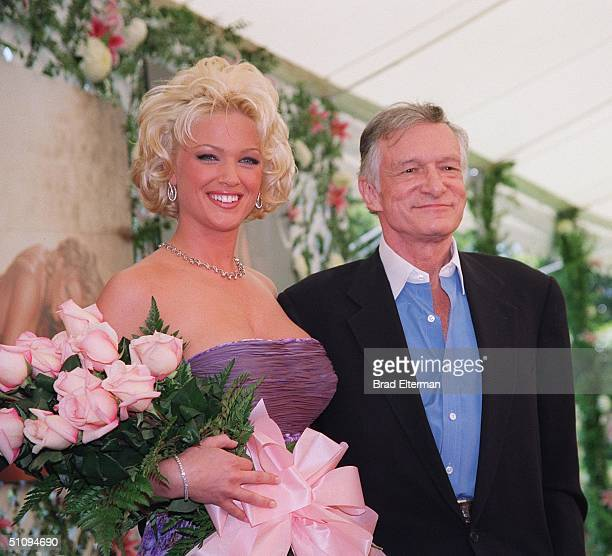 Holmby Hills Ca Hugh Hefner With 1999 Playmate Of The Year Heather Kozar At The Playboy Mansion