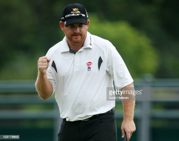 B Holmes celebrates as he holes a putt for birdie on the 18th green to finish with a tenunder par 60 during the third round of the Greenbrier Classic...