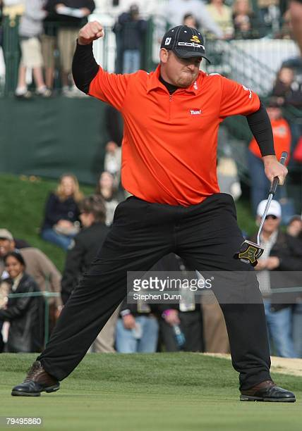B Holmes celebrates as his winning birdie putt drops on the first playoff hole during the final round of the FBR Open on February 3 2008 at TPC of...