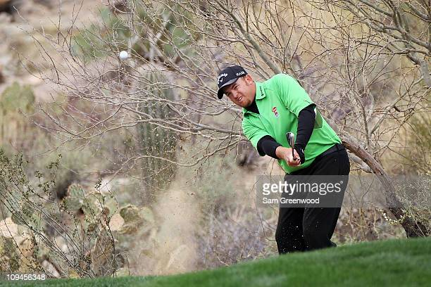 B Holmes hits a shot on the 18th hole after taking a drop during the quarterfinal round of the Accenture Match Play Championship at the RitzCarlton...