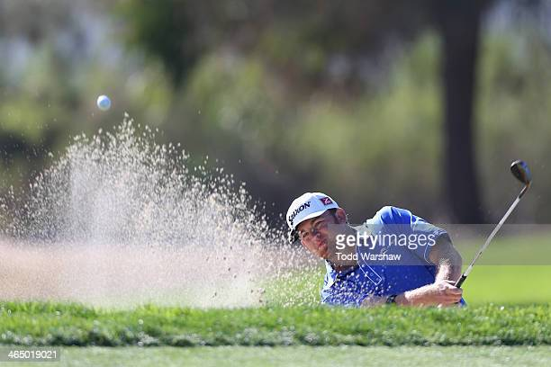 B Holmes hits a shot out of a bunker on the 6th hole during the third round of the Farmers Insurance Open on Torrey Pines South on January 25 2014 in...