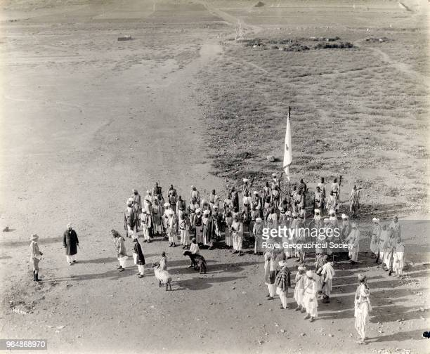 Holmes holding a Jiga in front of a group of Afghans North West Frontier Pakistan 1919