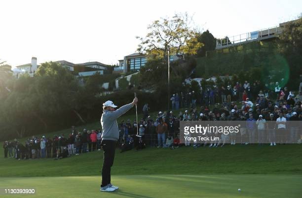 Holmes lines up a putt on the 18th hole green during the final round of the Genesis Open at Riviera Country Club on February 17, 2019 in Pacific...
