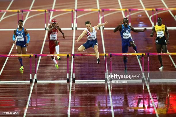 Holmes of the United States Abderrahaman Samba of Qatar Karsten Warholm of Norway and Kerron Clement of the United States compete in the Men's 400...