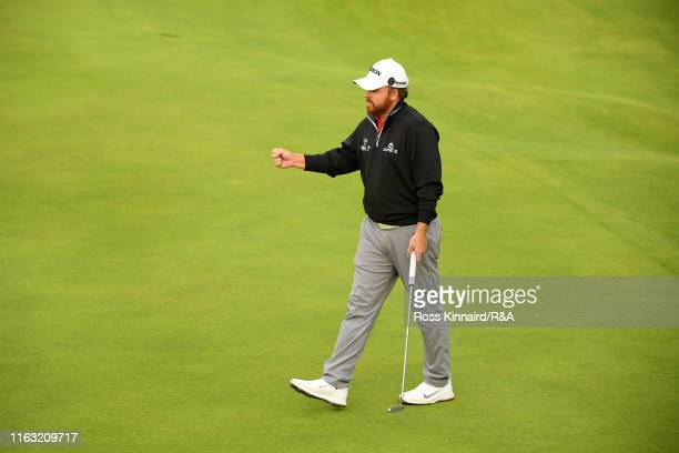 B Holmes of the United States celebrates on the 18th green during the third round of the 148th Open Championship held on the Dunluce Links at Royal...