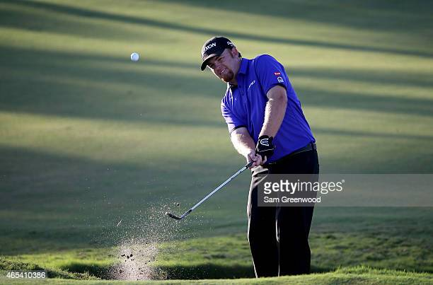 Holmes of the United States chips a shot out of the bunker on the sixteenth hole during the second round of the World Golf Championships-Cadillac...