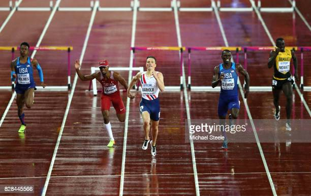 Holmes of the United States Karsten Warholm of Norway and Kerron Clement of the United States compete in the Men's 400 metres hurdles during day six...