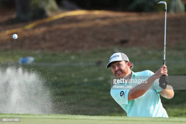 Holmes of the United States plays a shot from a bunker on the ninth hole during the second round of THE PLAYERS Championship at the Stadium course at...