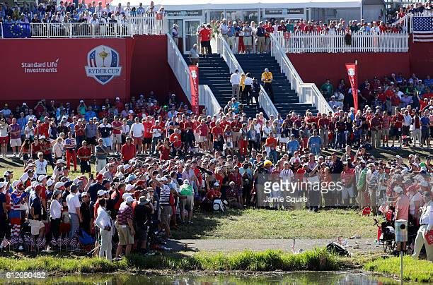 B Holmes of the United States plays a shot on the 16th hole during singles matches of the 2016 Ryder Cup at Hazeltine National Golf Club on October 2...