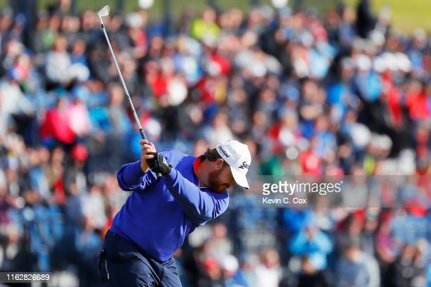 J B Holmes of the United States plays a shot on the 17th hole during the first round of the 148th Open Championship held on the Dunluce Links at...
