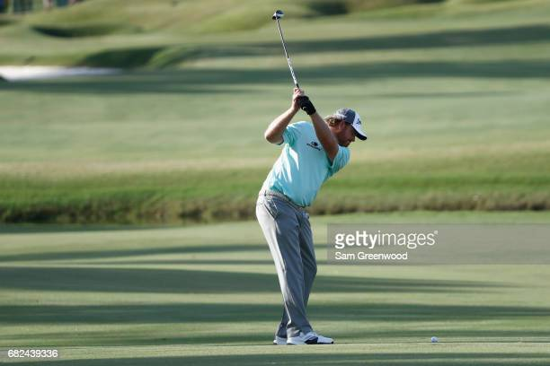 B Holmes of the United States plays a shot on the ninth hole during the second round of THE PLAYERS Championship at the Stadium course at TPC...