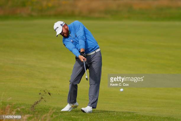 B Holmes of the United States plays a shot on the second hole during the second round of the 148th Open Championship held on the Dunluce Links at...