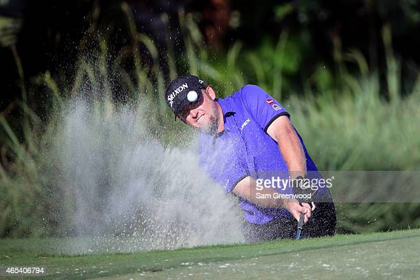 Holmes of the United States plays a shot out of the bunker on the thirteenth hole during the second round of the World Golf Championships-Cadillac...