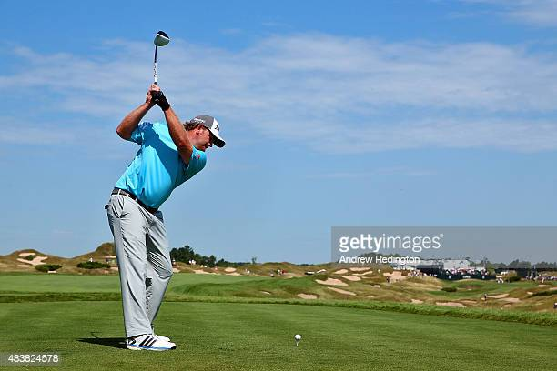 B Holmes of the United States plays his shot from the 11th tee during the first round of the 2015 PGA Championship at Whistling Straits on August 13...