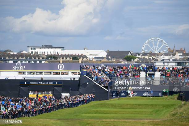 Holmes of the United States plays his shot from the first tee during the second round of the 148th Open Championship held on the Dunluce Links at...
