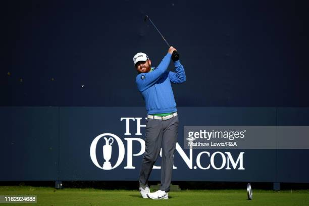 B Holmes of the United States plays his shot from the first tee during the second round of the 148th Open Championship held on the Dunluce Links at...