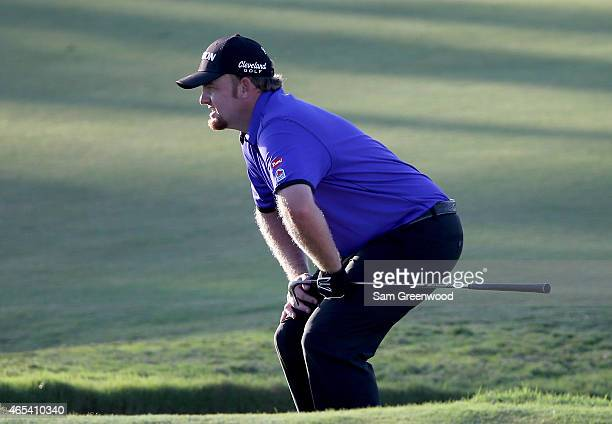Holmes of the United States react to a birdy chip on the sixteenth hole during the second round of the World Golf Championships-Cadillac Championship...