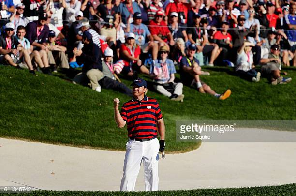 B Holmes of the United States reacts after a chip on the 16th hole during afternoon fourball matches of the 2016 Ryder Cup at Hazeltine National Golf...