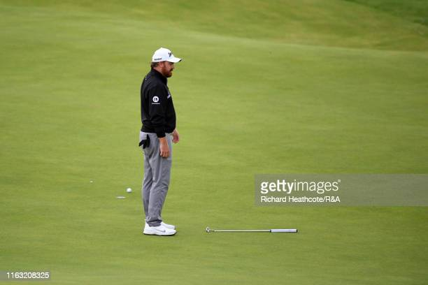 B Holmes of the United States reacts after a missed putt on the 17th green during the third round of the 148th Open Championship held on the Dunluce...