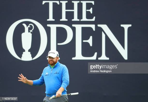 J B Holmes of the United States reacts on the 18th hole during the second round of the 148th Open Championship held on the Dunluce Links at Royal...