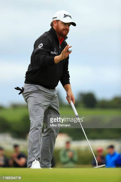 B Holmes of the United States reacts to a putt during the third round of the 148th Open Championship held on the Dunluce Links at Royal Portrush Golf...