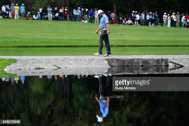 B Holmes of the United States walks over the stone bridge on the sixth hole during the third round of the World Golf Championships Mexico...