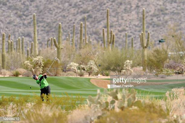 B Holmes plays an approach shot from the 18th fairway whilst playing the first playoff hole the 10th during his match against Bubba Watson during the...