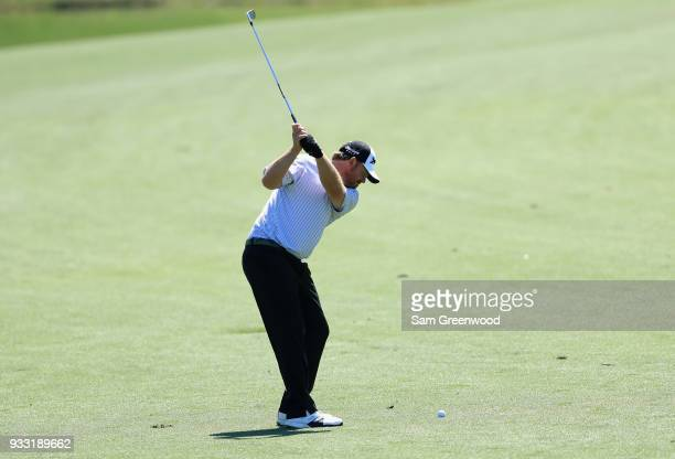 B Holmes plays his second shot on the eighth hole during the third round at the Arnold Palmer Invitational Presented By MasterCard at Bay Hill Club...