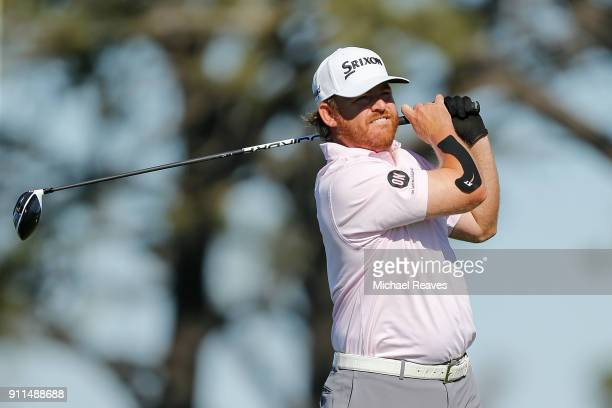 B Holmes plays his shot from the fifth tee during the final round of the Farmers Insurance Open at Torrey Pines South on January 28 2018 in San Diego...