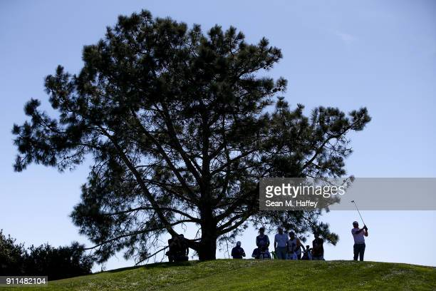 B Holmes plays his shot from the sixth tee during the final round of the Farmers Insurance Open at Torrey Pines South on January 28 2018 in San Diego...