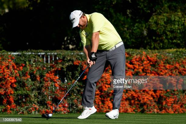 Holmes plays plays his shot from the second tee during the third round of the Waste Management Phoenix Open at TPC Scottsdale on February 01, 2020 in...