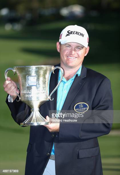 Holmes poses with the trophy after securing victory in the final round of the Wells Fargo Championship at the Quail Hollow Club on May 4 2014 in...