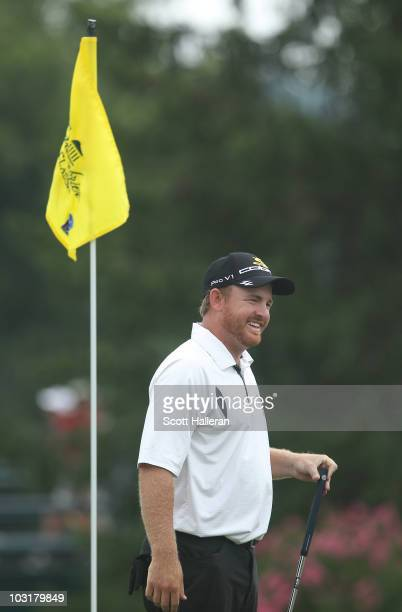 B Holmes smiles after he holed a putt for birdie on the 18th green to finish with a tenunder par 60 during the third round of the Greenbrier Classic...