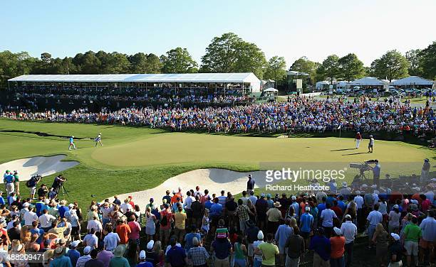 Holmes walks up onto the 18th green to secure victory in the final round of the Wells Fargo Championship at the Quail Hollow Club on May 4 2014 in...