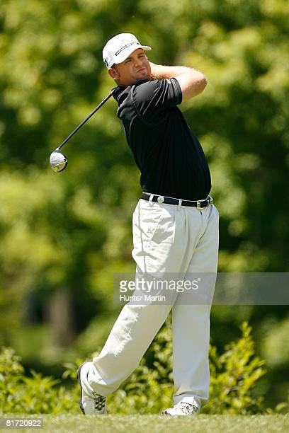 B Holmes watches his shot during the first round of the Memorial Tournament at Muirfield Village Golf Club on May 29 2008 in Dublin Ohio