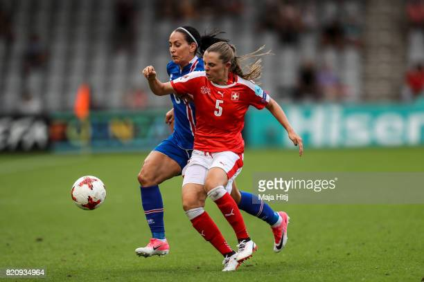 Holmfridur Magnusdottir of Iceland and Noelle Maritz of Switzerland battle for the ball during the UEFA Women's Euro 2017 Group C match between...