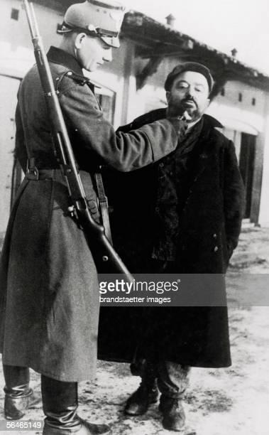 Holocaust A german soldier are cutting the beard of a jewish man Around 1940 Photograph [Holocaust Deutscher Militaerpolizist schneidet einem...